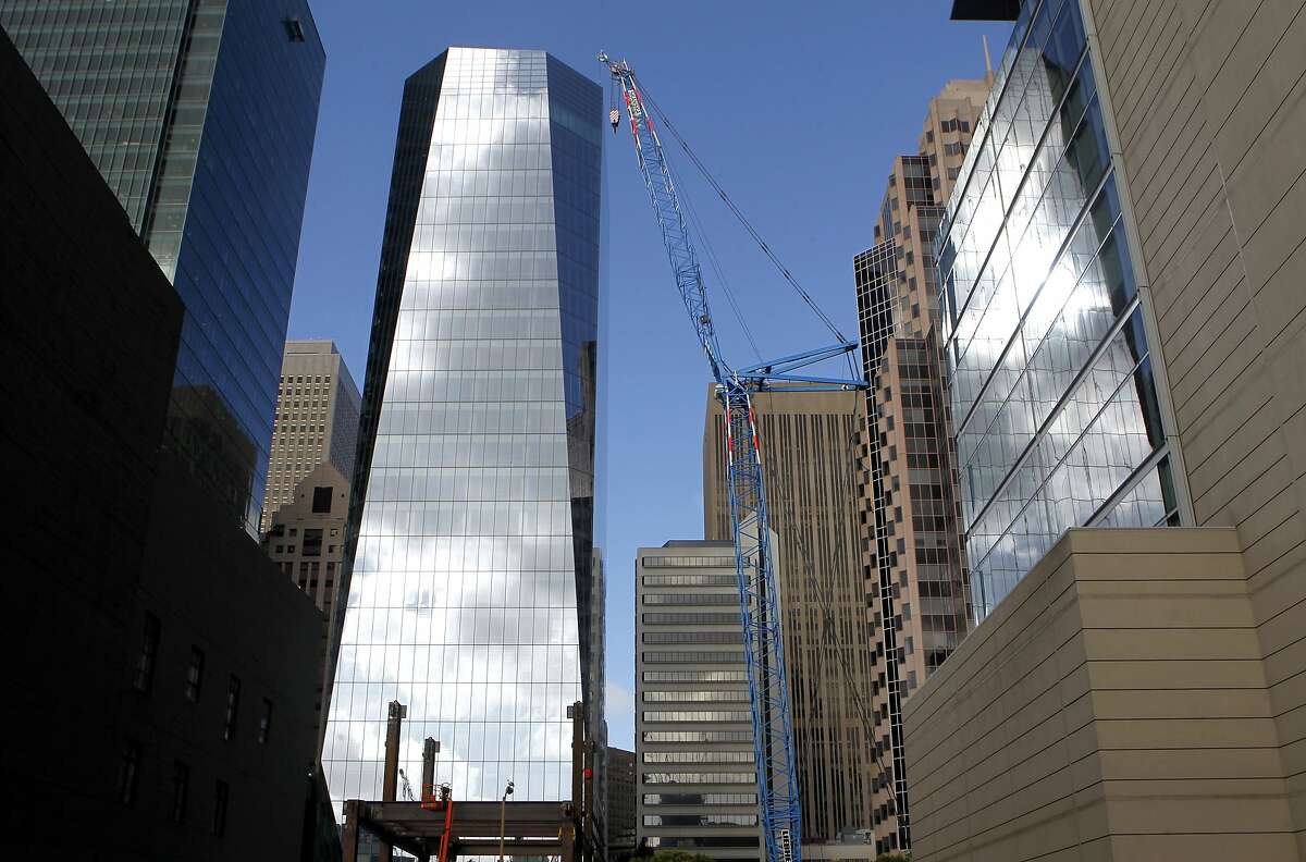 The 27-story 535 Mission Street office tower rises above the Transbay Transit Center construction project in San Francisco, Calif. on Friday, Nov. 14, 2014.