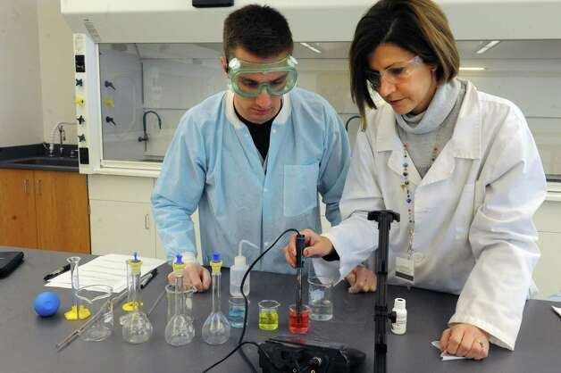 Chemistry Professor Donna Barron, Phd., right, works with student Michael Marinello on a ph meter buffer preparation exercise during her organic chemistry class at Hudson Valley Community College on Friday, Nov. 14, 2014, in Troy, N.Y. (Michael P. Farrell/Times Union) Photo: Michael P. Farrell / 00029489A