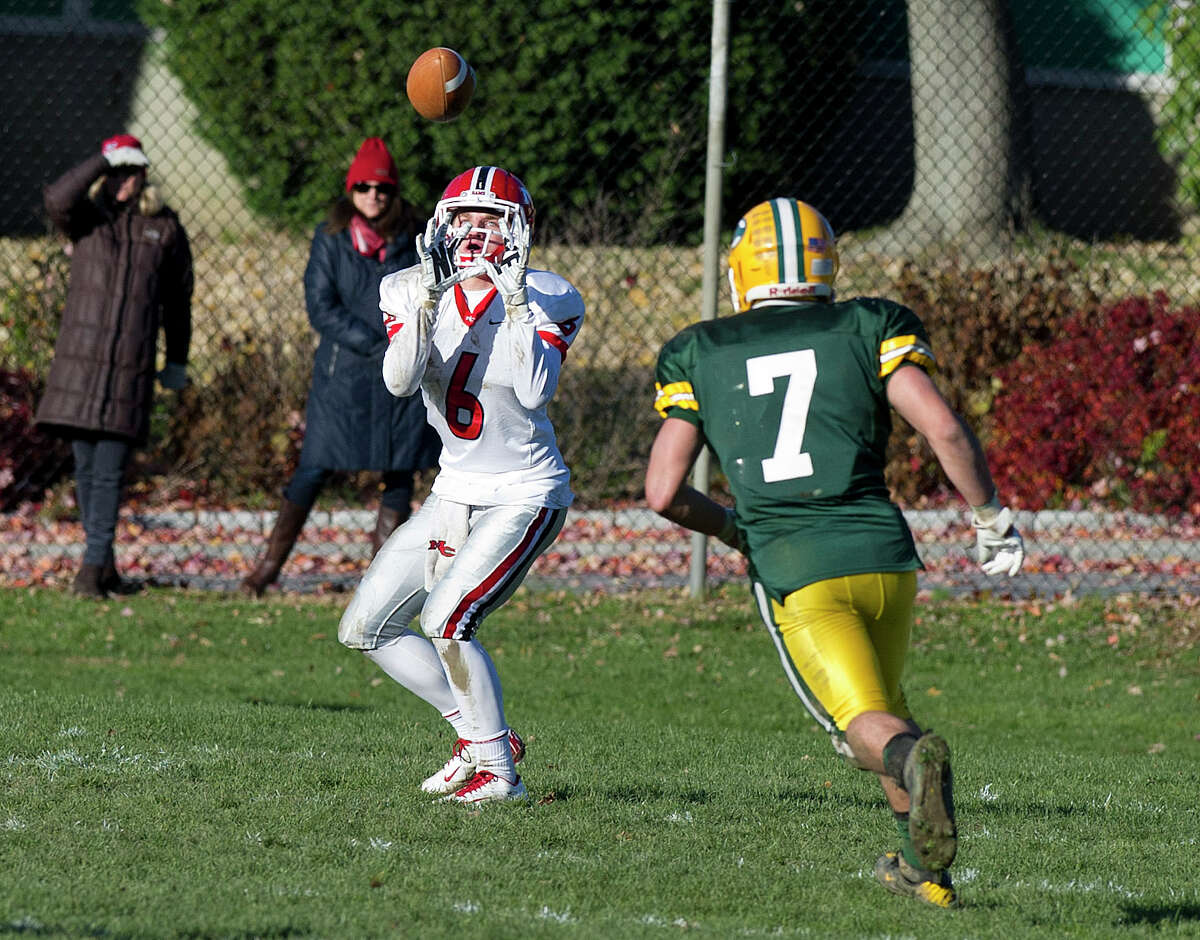 New Cannan's Michael Kraus makes a catch for a touchdown during Saturday's football game at Trinity Catholic High School on November 15, 2014.
