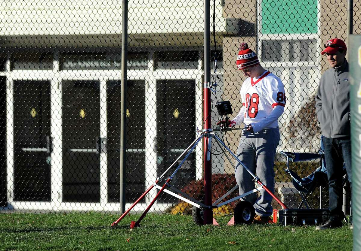 A camera is operated for the New Canaan football team during Saturday's football game at Trinity Catholic High School on November 15, 2014.