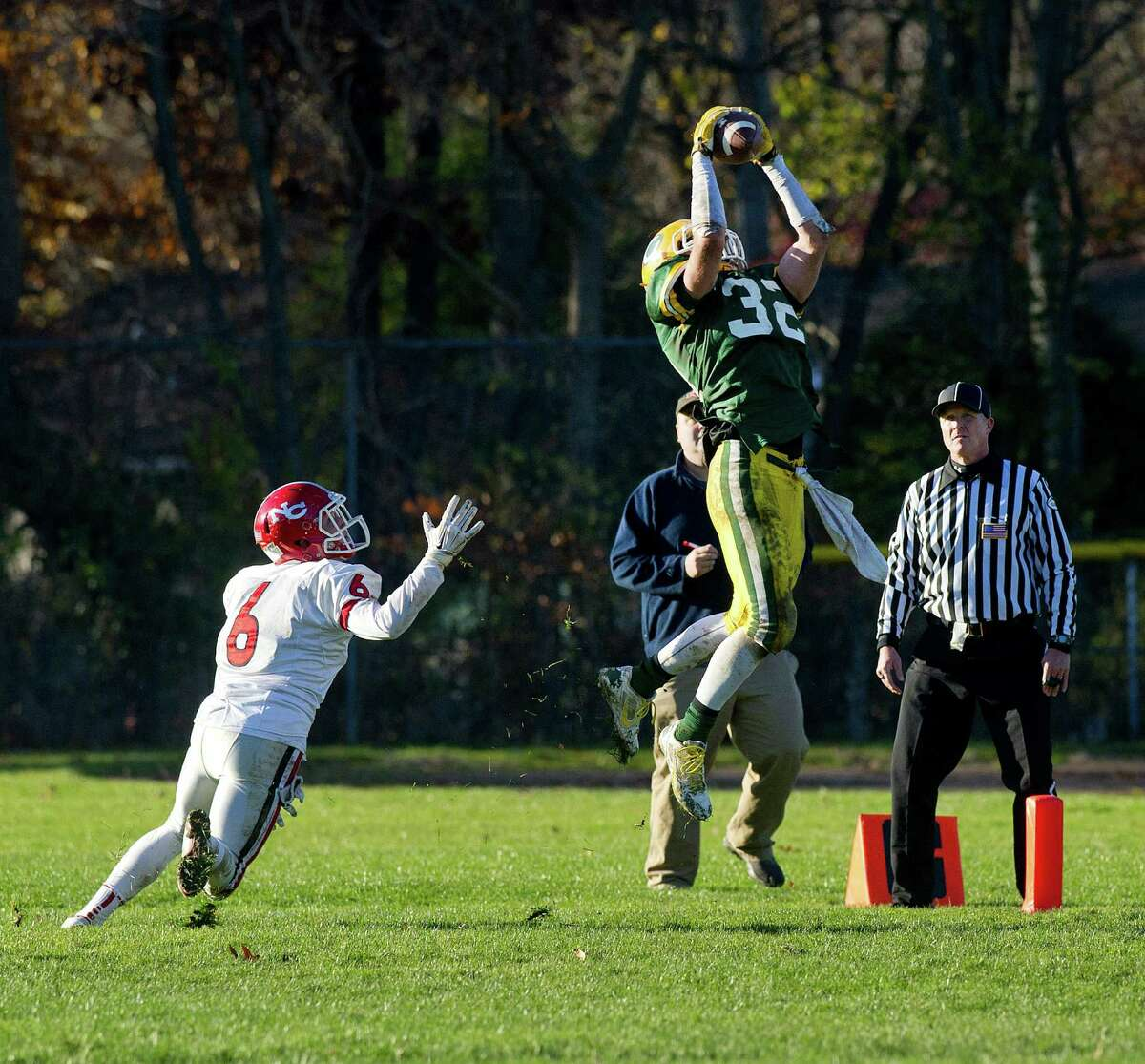 Trinity Catholic's Thomas Costigan makes a catch in the end zone for a touchdown during Saturday's football game at Trinity Catholic High School on November 15, 2014.