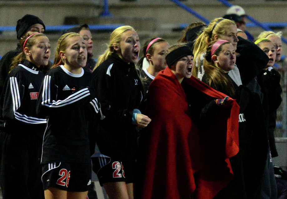 Fairfield Warde team members react as they hope for a goal in overtime, during CIAC Class LL state girls soccer championship action against Glastonbury in West Haven, Conn. on Saturday Nov. 15, 2014. Glastonbury held on to its lead, beating Warde in double overtime, 2-1. Photo: Christian Abraham / Connecticut Post