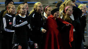 Fairfield Warde team members react as they hope for a goal in overtime, during CIAC Class LL state girls soccer championship action against Glastonbury in West Haven, Conn. on Saturday Nov. 15, 2014. Glastonbury held on to its lead, beating Warde in double overtime, 2-1.