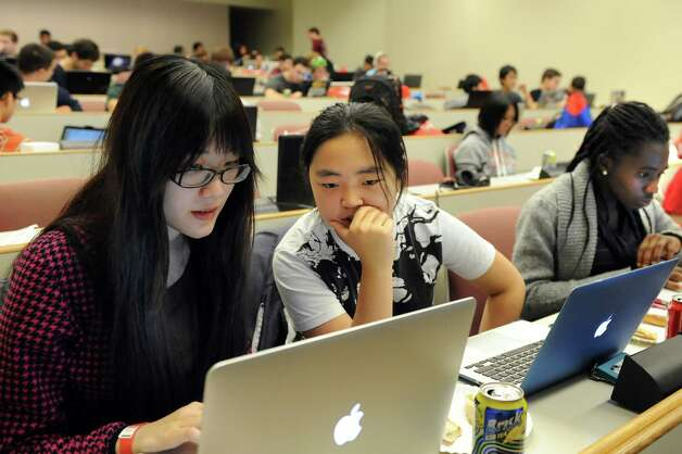 Smith College students Tainya Xu, 21, left, and Li Chai, 20, center, work on an Adroid app during HackRPI on Saturday, Nov. 15, 2014, at Rensselaer Polytechnic Institute in Troy, N.Y. At right is their teammate Zuliat Owoade, 20, also a Smith College student. (Cindy Schultz / Times Union) Photo: Cindy Schultz / 00029508A