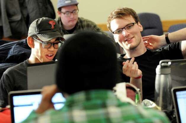 Temple University students Jeff Diana, 22, left, and Zack Smith, 21, right, work on a project during HackRPI on Saturday, Nov. 15, 2014, at Rensselaer Polytechnic Institute in Troy, N.Y. They wanted to create a program where a physical exercise would be required to turn off an alarm clock. (Cindy Schultz / Times Union) Photo: Cindy Schultz / 00029508A