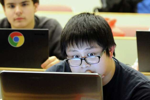 Shelton (Conn.) High student William Lin, 17, right, works to create an Android app during HackRPI on Saturday, Nov. 15, 2014, at Rensselaer Polytechnic Institute in Troy, N.Y. (Cindy Schultz / Times Union) Photo: Cindy Schultz / 00029508A