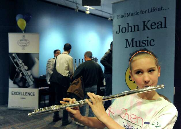 Twelve-year-old Mary Goodell of Clifton Park tries out a flute during the John Keal Music Company sponsored professional music instrument fair as representatives from major manufacturers Yamaha, Conn-Selmer, Buffet Group, and Jupiter were on hand with dozens of top-level brand instruments direct from the factory in the Fenimore Room at Proctors on Saturday Nov. 15, 2014 in Schenectady, N.Y. (Michael P. Farrell/Times Union) Photo: Michael P. Farrell / 00029421A