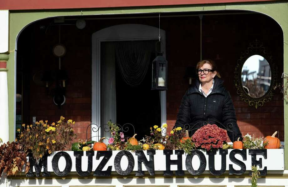 Diane Pedinotti stands on the front porch of the Mouzon House Friday afternoon Nov. 14, 2104 in Saratoga Springs, N.Y.       (Skip Dickstein/Times Union) Photo: SKIP DICKSTEIN / 00029479A