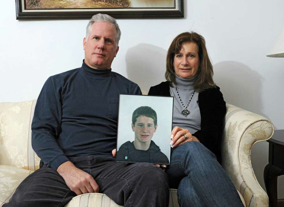 Kevin & Diane Flood, whose son, Dan, 24, has battled heroin addiction for more than 6 years and has been homeless in Albany for several months, hold a photo of him at their home on Thursday, Nov. 6, 2014 in Albany, N.Y. (Lori Van Buren / Times Union) Photo: Lori Van Buren / 00029379A