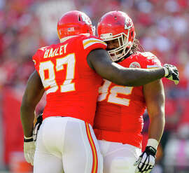 Chiefs defensive end Allen Bailey (left) celebrates a sack against the Rams last month with nose tackle Dontari Poe. Bailey and the Chiefs agreed to a four-year, $25 million contract extension Saturday.
