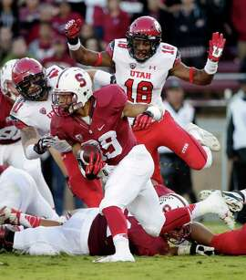 Stanford running back Kelsey Young, center, runs against Utah during the first half of an NCAA college football game on Saturday, Nov. 15, 2014, in Stanford, Calif. (AP Photo/Marcio Jose Sanchez)