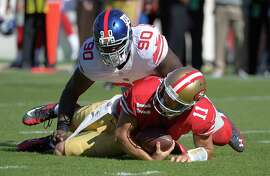 New York Giants defensive end Jason Pierre-Paul (90) sacks San Francisco 49ers quarterback Alex Smith (11) during the first half of an NFL football game in San Francisco, Sunday, Oct. 14, 2012. (AP Photo/Mark J. Terrill)
