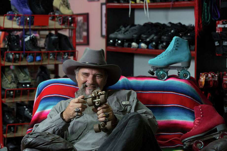John McKay, holding a vintage clamp-on skate, says his passion for skating has allowed his niche business to survive. Photo: Johnny Hanson, Staff / © 2014  Houston Chronicle