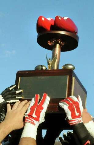The RPI team hoists the Dutchman Shoes Trophy after beating Union 31-28 in their football matchup on Saturday, Nov. 15, 2014, at Rensselaer Polytechnic Institute in Troy, N.Y. (Cindy Schultz / Times Union) Photo: Cindy Schultz / 00029476A