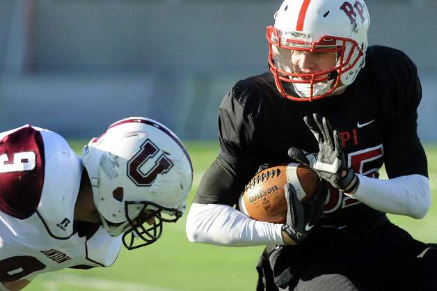 RPI's Logan Gaddar, right, tries to fend off a tackle from Union's Kyle Hanney during their football game on Saturday, Nov. 15, 2014, at Rensselaer Polytechnic Institute in Troy, N.Y. (Cindy Schultz / Times Union) Photo: Cindy Schultz / 00029476A