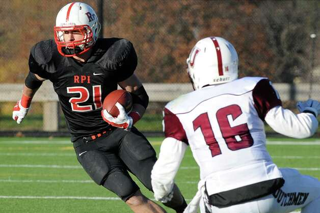 RPI's Nick Schlatz, left, carries the ball as Union's Liam Collins defends during their football game on Saturday, Nov. 15, 2014, at Rensselaer Polytechnic Institute in Troy, N.Y. (Cindy Schultz / Times Union) Photo: Cindy Schultz / 00029476A