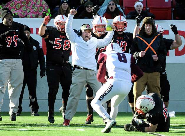 RPI head coach Ralph Isernia, center, and his team celebrate on the sideline when Casey McHugh, right, recovers an onside kick during their football game against Union on Saturday, Nov. 15, 2014, at Rensselaer Polytechnic Institute in Troy, N.Y. (Cindy Schultz / Times Union) Photo: Cindy Schultz / 00029476A