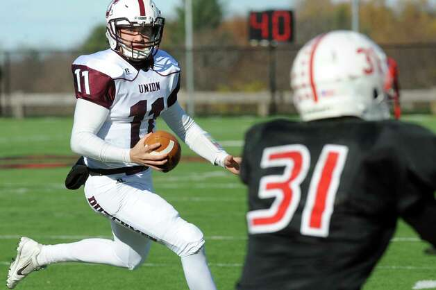 Union's quarterback Connor Eck, left, runs the ball as RPI's Philip Lanieri III defends during their football game on Saturday, Nov. 15, 2014, at Rensselaer Polytechnic Institute in Troy, N.Y. (Cindy Schultz / Times Union) Photo: Cindy Schultz / 00029476A