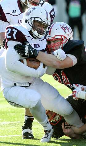 Union's Darnell Thomas, left, tries to hold his position as RPI's Anthony Pilla defends during their football game on Saturday, Nov. 15, 2014, at Rensselaer Polytechnic Institute in Troy, N.Y. (Cindy Schultz / Times Union) Photo: Cindy Schultz / 00029476A