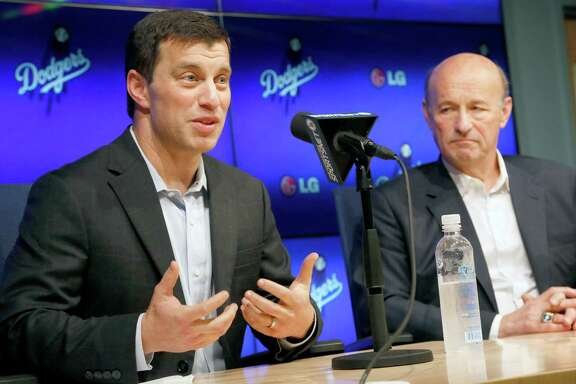 Andrew Friedman, left, a 38-year-old Houston native and former Wall Street analyst, was hired away from the Tampa Bay Rays by the Los Angeles Dodgers to help give the West Coast club a high-powered, high-priced front office.