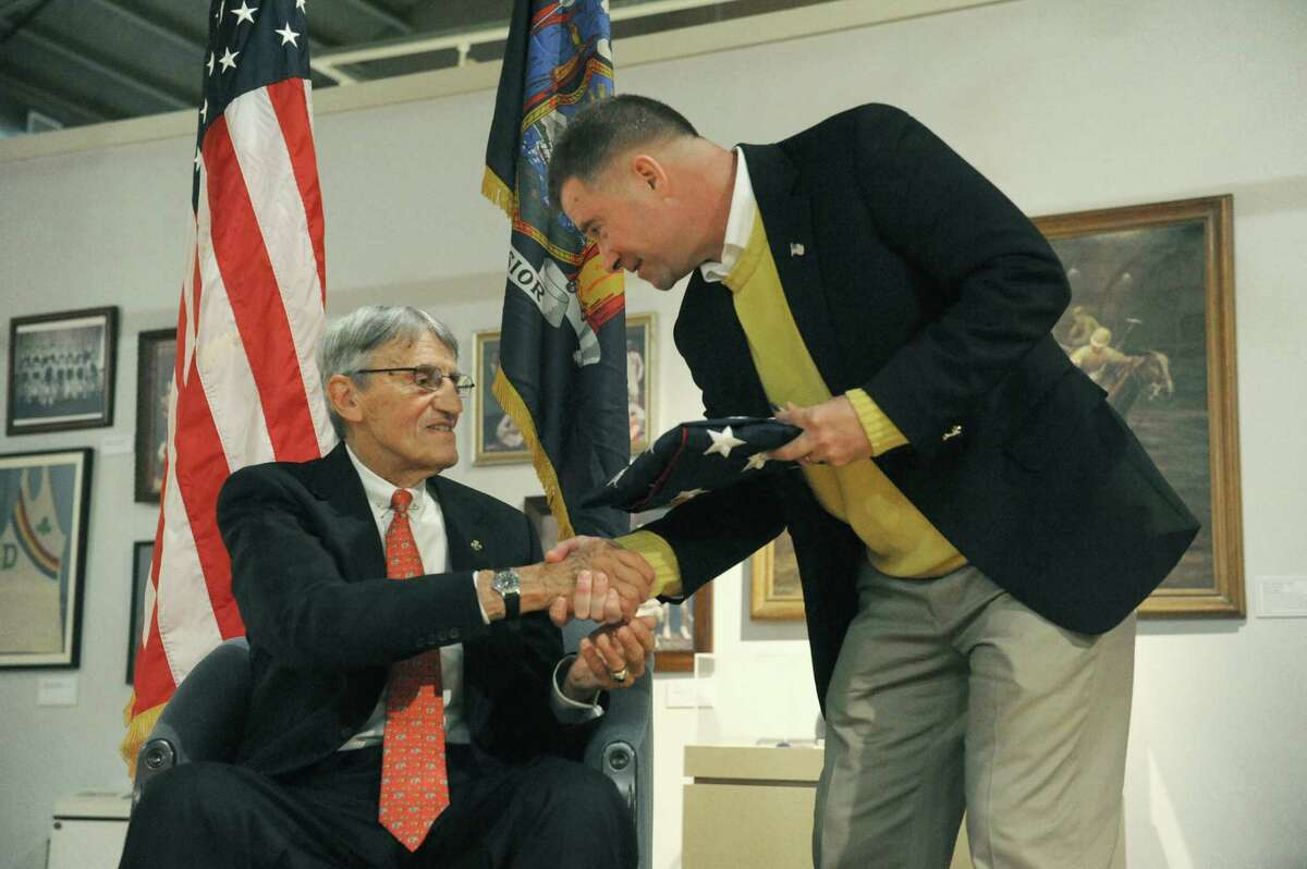 Rep. Chris Gibson, right, presents retired Army Colonel Charles R. Johnson, a veteran of the Vietnam War, with a flag flown over the U.S. Capitol as Johnson was honored as Veteran of Year during a ceremony at the New York State Military Museum on Saturday Nov. 15, 2014 in Saratoga Springs, N.Y. (Michael P. Farrell/Times Union)