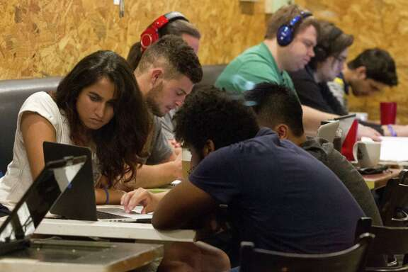 UH students study at the Nook Cafe on campus, a gathering spot that offers a quiet contrast to the boisterous scene at the nearby Calhoun's Rooftop Bar.