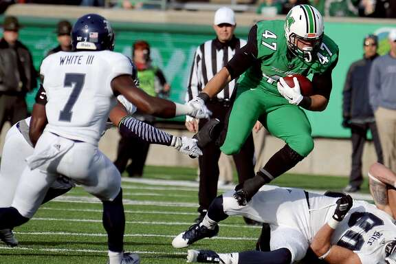 Marshall's Devon Johnson picks up a portion of his 199 rushing yards.