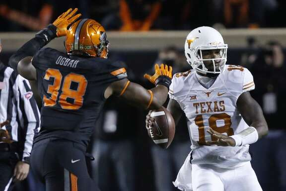 Texas quarterback Tyrone Swoopes (18) passes under pressure from Oklahoma State's Emmanuel Ogbah (38) in the first quarter of an NCAA college football game in Stillwater, Okla., Saturday, Nov. 15, 2014. (AP Photo/Sue Ogrocki)