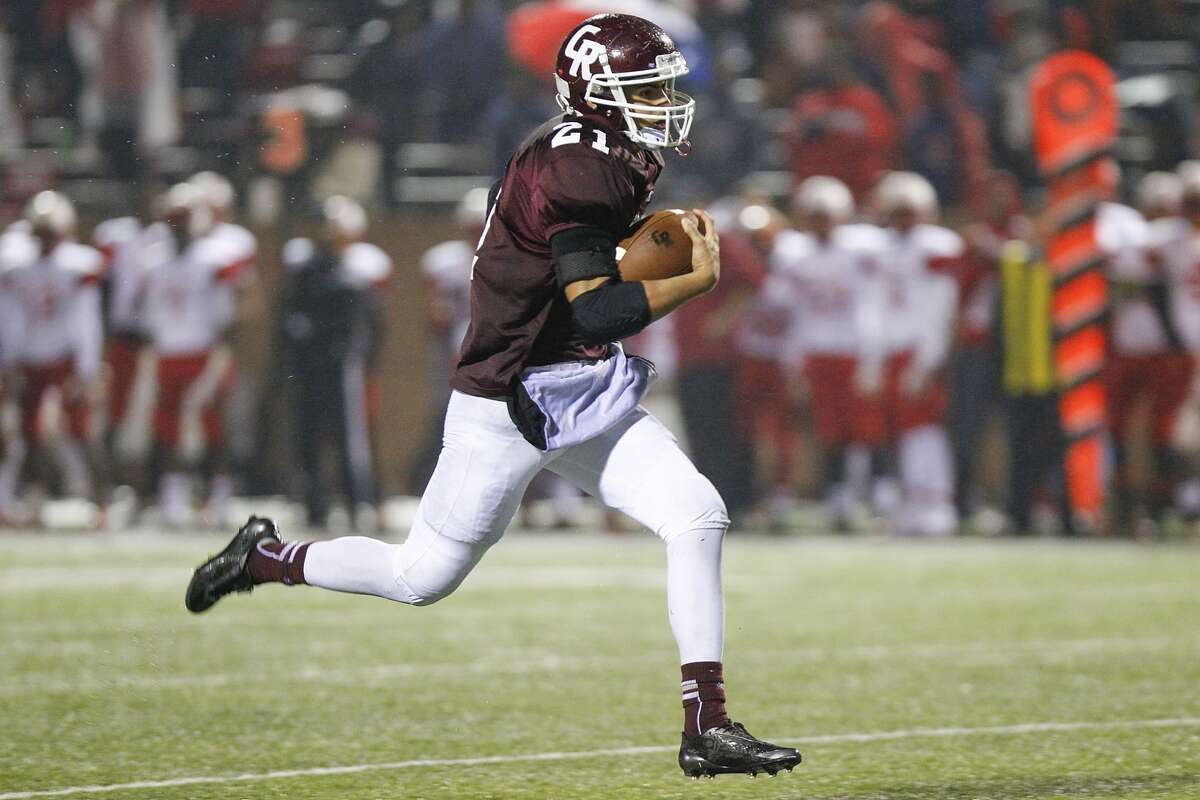 Cinco Ranch's Jonathan Lugo runs for a touchdown during the third quarter as the Cougars hosted Bellaire in the 6A Bi-District playoffs at Rhodes Stadium on November 15, 2014.