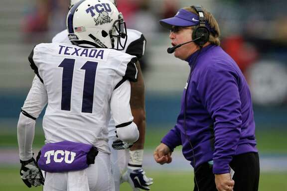 TCU coach Gary Patterson, right, tries to inspire members of a defense that gave up 418 yards.