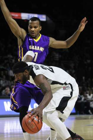 Saturday November 15, 2014 Providence, RI Providence College basketball hosts Albany at the Dunkin Donuts Center in Providence. #23 LaDontae Henton of Providence College tries to get by the defense of #1 Ray Sanders of UAlbany. (The Providence Journal / Bob Breidenbach) ORG XMIT: PJC1411152056184157 Photo: Bob Breidenbach / 00025056A The Providence Journal