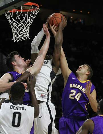Saturday November 15, 2014 Providence, RI Providence College basketball hosts Albany at the Dunkin Donuts Center in Providence. #10 Mike Rowley (left) and #24 Dallas Ennema of UAlbany battle for a rebound against #23 LaDontae Henton of Providence College. (The Providence Journal / Bob Breidenbach) ORG XMIT: PJC1411152055584150 Photo: Bob Breidenbach / 00025056A The Providence Journal
