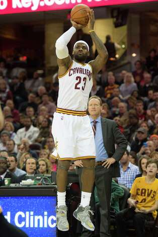 CLEVELAND, OH - NOVEMBER 15: LeBron James #23 of the Cleveland Cavaliers shoots against the Atlanta Hawks during the first half at Quicken Loans Arena on November 15, 2014 in Cleveland, Ohio. NOTE TO USER: User expressly acknowledges and agrees that, by downloading and/or using this photograph, user is consenting to the terms and conditions of the Getty Images License Agreement.   (Photo by Jason Miller/Getty Images) ORG XMIT: 508084409 Photo: Jason Miller / 2014 Getty Images