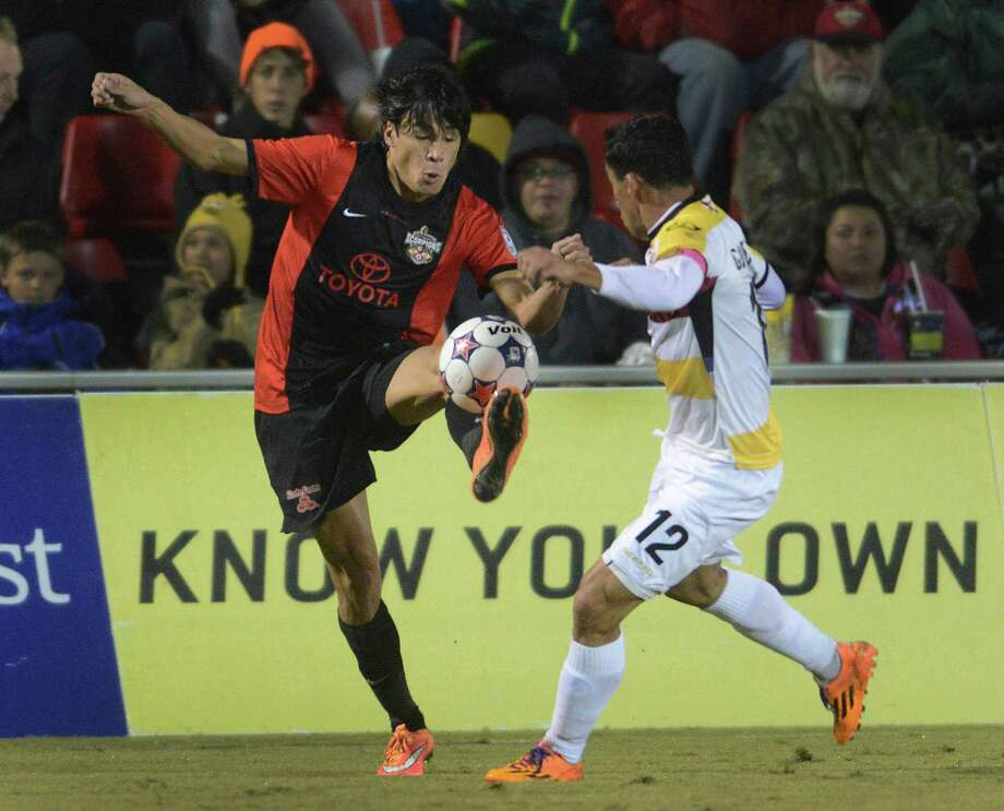 Walter Restrepo of the San Antonio Scorpions kicks the ball as Ivan Guerrero of the Ft. Lauderdale Strikers defends during the first half of the NASL Championship Final at Toyota Field on Saturday, Nov. 15, 2014. Photo: Billy Calzada, San Antonio Express-News / San Antonio Express-News