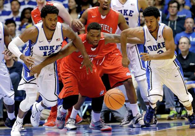 Duke's Justise Winslow (12) and Quinn Cook, right, chase the ball with Fairfield's K.J. Rose during the second half of an NCAA college basketball game in Durham, N.C., Saturday, Nov. 15, 2014. Duke won 109-59. (AP Photo/Gerry Broome) ORG XMIT: NCGB127 Photo: Gerry Broome / AP