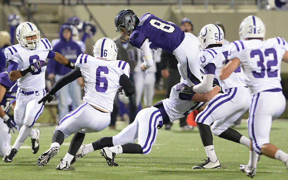 Port Neches-Groves' Caisen Sullivan is knocked off his feet by Dayton defenders as they move in for the tackle during their playoff game Saturday at Stallworth Stadium.  Photo taken Saturday, November 15, 2014 Kim Brent/The Enterprise Photo: KIM BRENT / Beaumont Enterprise