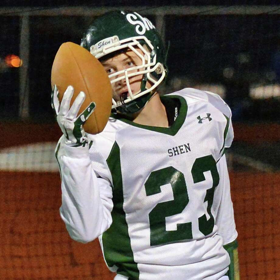 Shen's #23 Jordan Zlogar holds up the ball after scoring on a Ryan Van Galen TD pass during the Class AA quarterfinal football game against John Jay-East Fishkill at Dietz Stadium Saturday Nov. 15, 2014, in Kingston, NY.   (John Carl D'Annibale / Times Union) Photo: John Carl D'Annibale / 00029472A