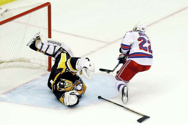 New York Rangers' Dan Boyle (22) gets past a diving Pittsburgh Penguins goalie Marc-Andre Fleury (29) to shoot in the shootout of an NHL hockey game, Saturday, Nov. 15, 2014, in Pittsburgh. The puck got past Fleury, but the goal was disallowed and the Penguins won 3-2 in the shootout. (AP Photo/Keith Srakocic) ORG XMIT: PAKS115 Photo: Keith Srakocic / AP