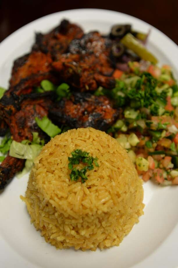 Seasoned, grilled lamb chops are accompanied with sides including curried rice and salad at Al Basha Mediterranean Grill, located off the I-10 access road in Beaumont. Photo taken Wednesday, November 5, 2014 Kim Brent/@kimbpix