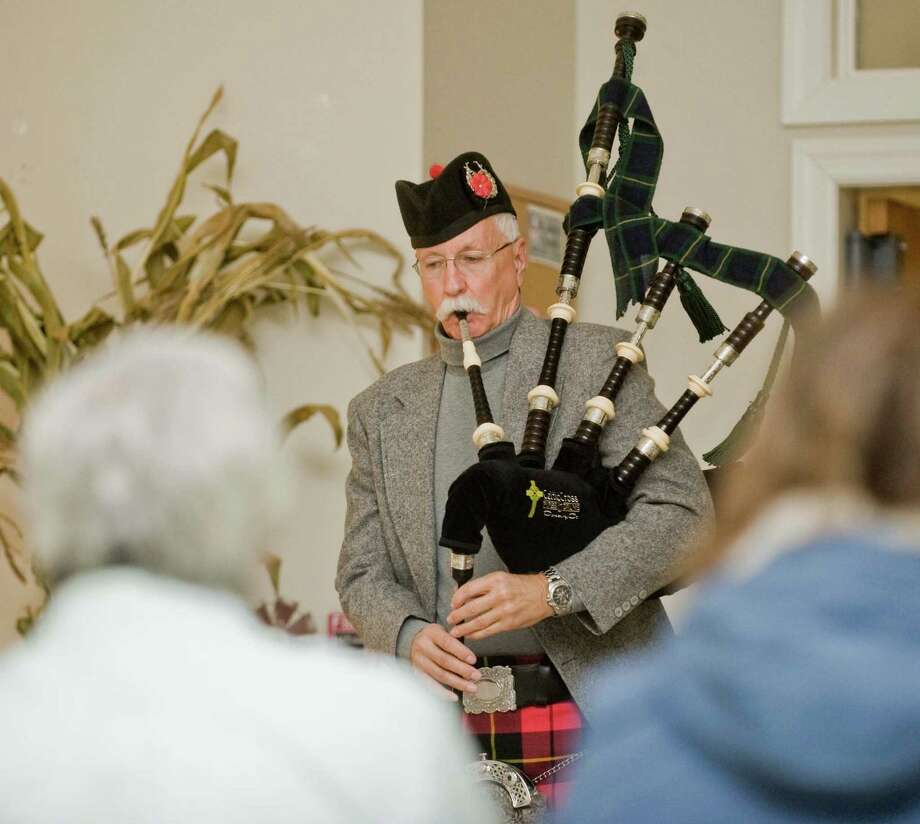 Donald P. Hicks performs on the bagpipes during the Voices of Poetry Thanks for the Giving III event at St. John's Episcopal Church in New Milford. Saturday, Nov. 15, 2014 Photo: Scott Mullin / The News-Times Freelance