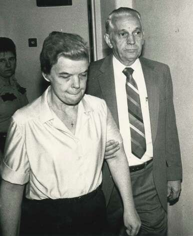 Mary Beth Tinning is escorted into the Schenectady courtroom by Sheriff Bernard Waldron, right, for her sentencing Sept. 24, 1987, in Schenectady, N.Y. (Paul Kniskern Sr./Times Union)