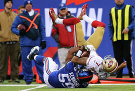 Devon Kennard takes down Colin Kaepernick in the first quarter as the 49ers' offense continued to sputter too often.