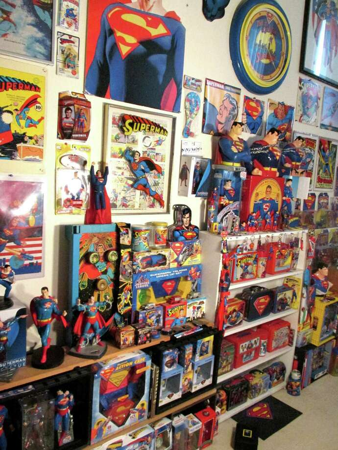 Former Greenwich Country Day School science teacher Jim Arden has a number of large collections including one featuring Superman memorabilia. Photo: Anne Semmes / Greenwich Time