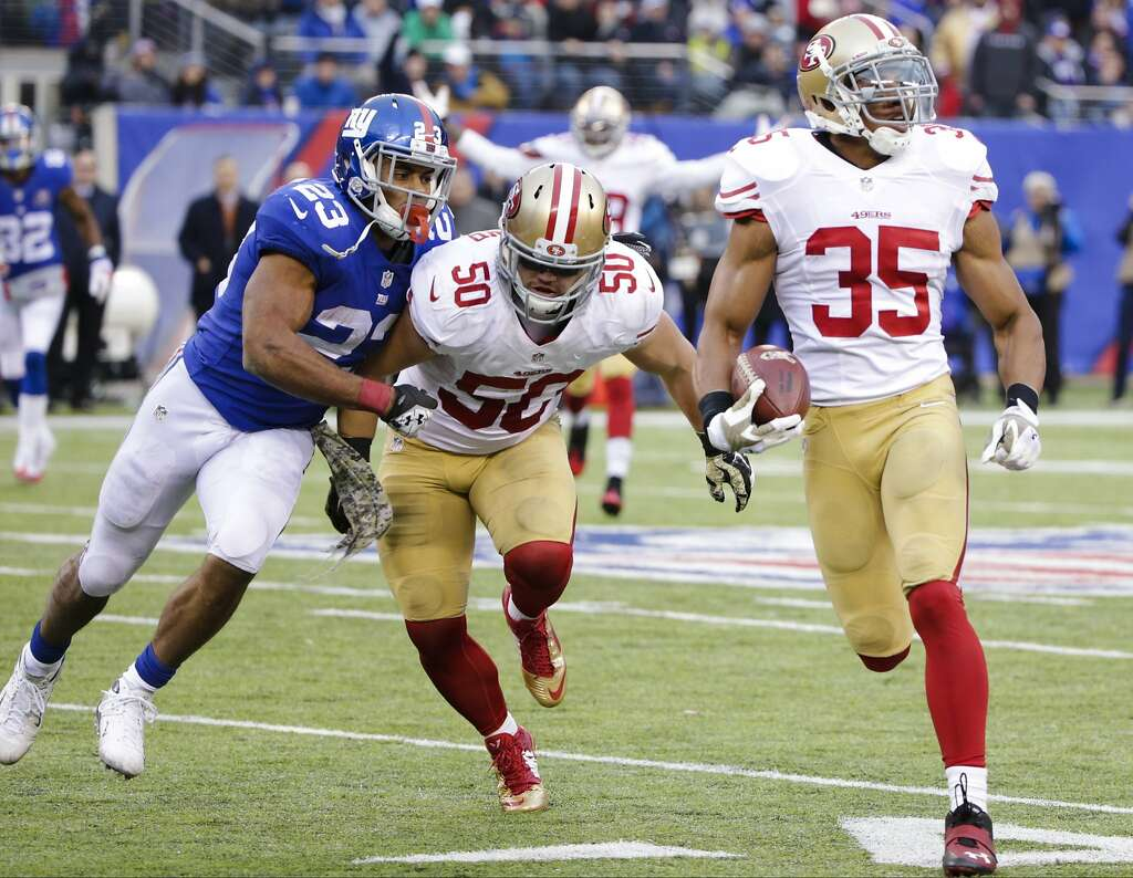 145d10d28 ... 49ers free safety Eric Reid (35) runs back an interception as Chris  Youth San Francisco 49ers Colin Kaepernick Nike Scarlet Team Color Game  Jersey ...