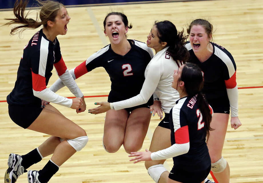 Members of the Churchill Chargers volleyball team celebrate their win over the Clark Cougars during their Region IV-6A volleyball final match on Nov. 15, 2014 at Alamo Convocation Center. Photo: Edward A. Ornelas /San Antonio Express-News / © 2014 San Antonio Express-News