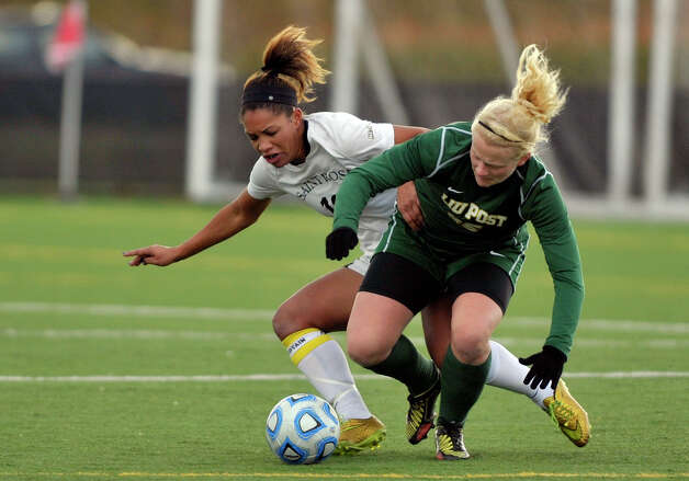 Jourdan Thompson, left, with the College of Saint Rose battles a LIU Post player for the ball during the second round of the NCAA Division II Women's Soccer Championship on Sunday, Nov. 16, 2014, in Albany, N.Y.  The College of Saint Rose last week suspended head coach Laurie Darling Gutheil for the remainder of the season.  (Paul Buckowski / Times Union) Photo: Paul Buckowski / 00029513A