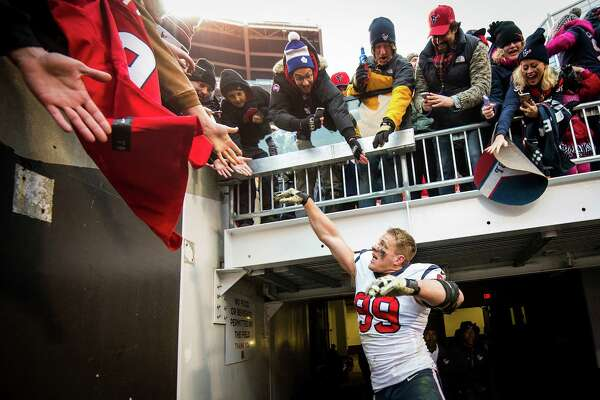 Houston Texans defensive end J.J. Watt celebrates with fans after the Texans victory over the Cleveland Browns in NFL football game at FirstEnergy Stadium on Sunday, Nov. 16, 2014, in Cleveland.