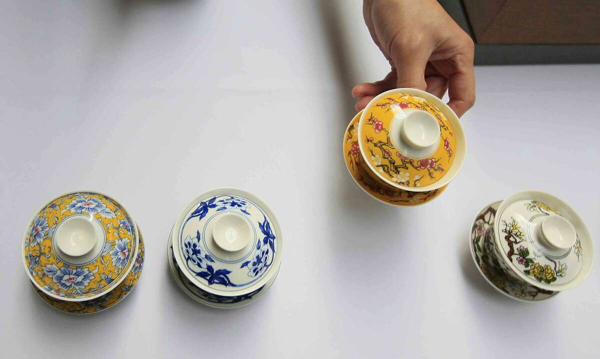 Masaki Sato of Imperial Tea Court in San Francisco arranges tea cups during the 3rd Annual San Francisco International Tea Festival in San Francisco's Ferry Building Sunday, November 16, 2014.