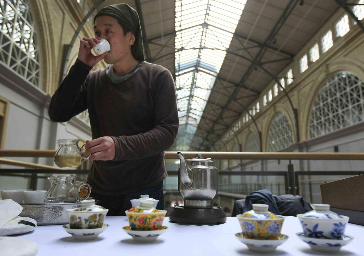 Masaki Sato of Imperial Tea Court in San Francisco tests freshly brewed tea during the 3rd Annual San Francisco International Tea Festival in San Francisco's Ferry Building Sunday, November 16, 2014.