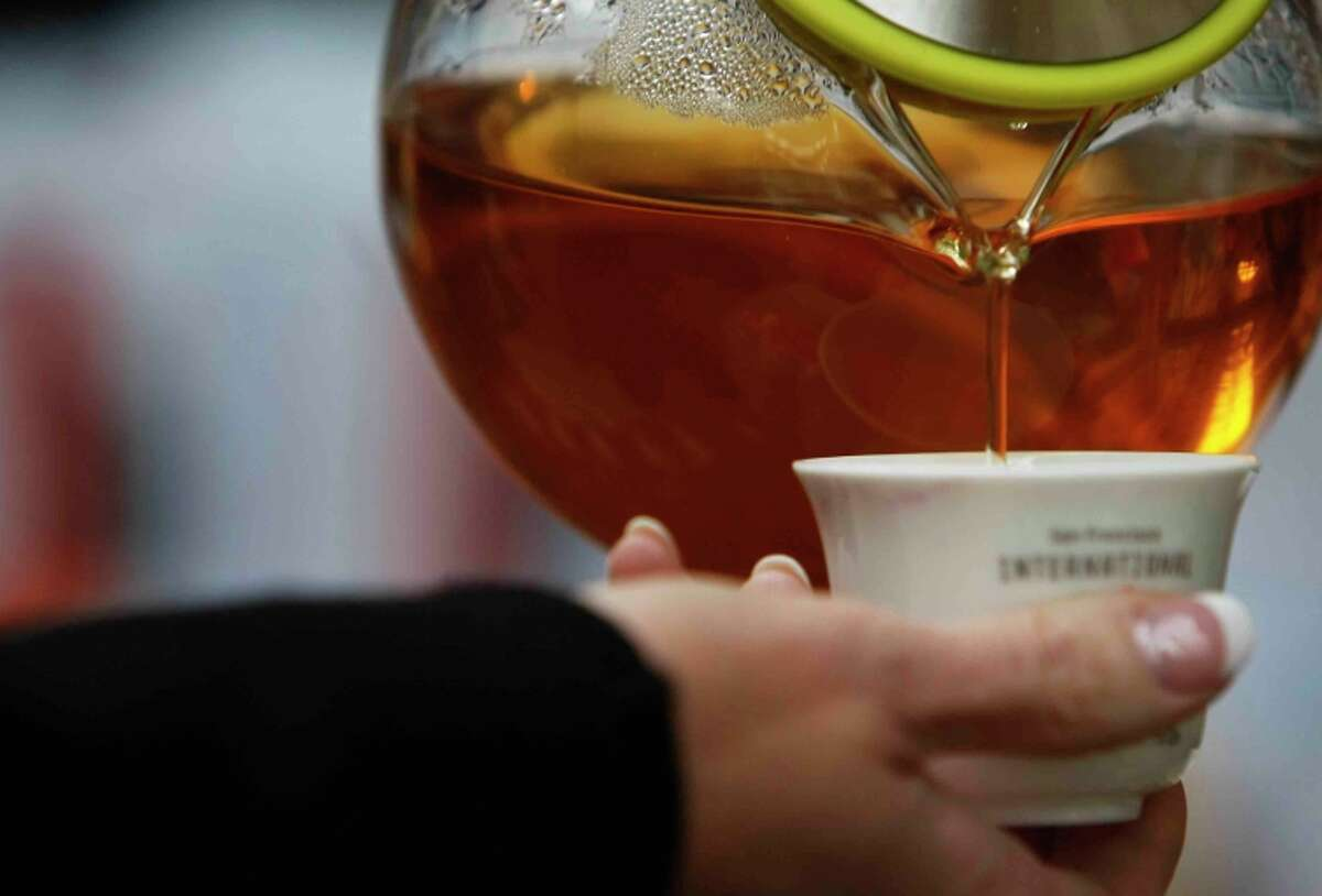 Devan Shah of Chado Tea pours a sample during the festival in San Francisco's Ferry Building.